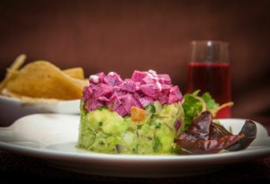 Guacamole with tangy, pickled beet topping